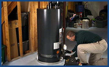 A picture of a technician repairing a water heater